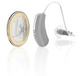 Hörgerät neben 1 Euro Münze
